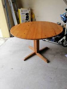 Round wooden 4 seater table