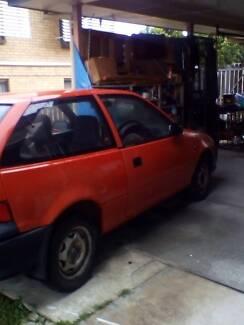 Red Suzuki Swift 1991