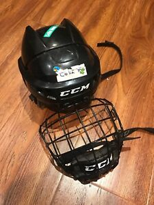 Youth CCM hockey helmet with cage