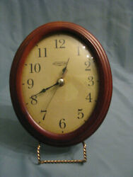 OVAL CHERRYWOOD WALL CLOCK
