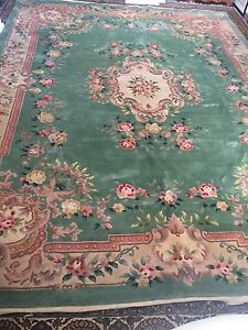 Large handmade floral wool area rug negotiable/delivery