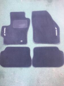 Used OEM Mazda 3 2004-2008 summer mats and cargo divider.