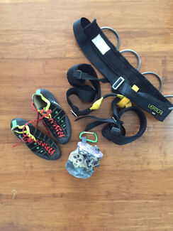Rock climbing shoes, harness and chalk bag
