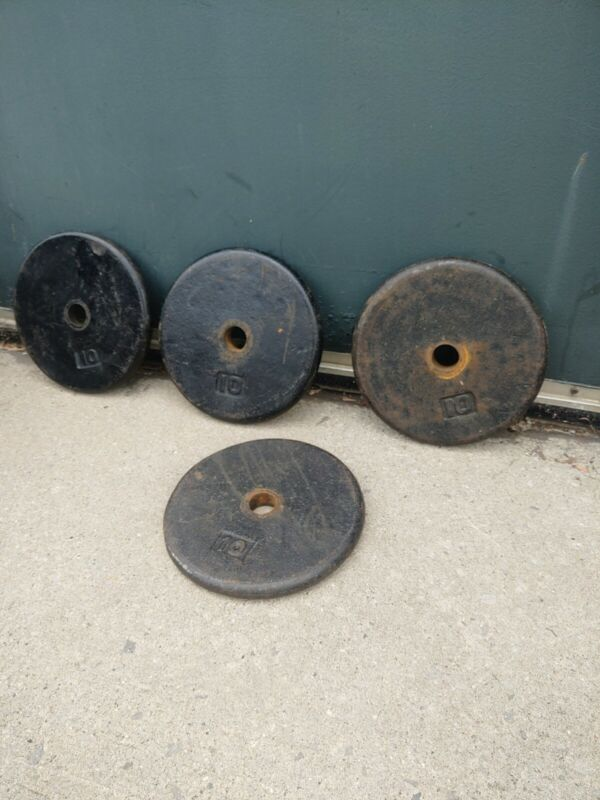 (4) weight lifter plates pancake standard hole. unknown brand. Ship for free