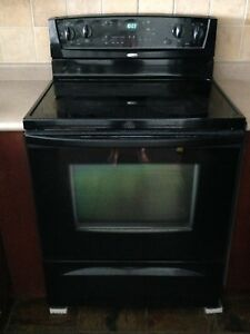 Whirlpool electric stove, dish washer, fridge, black
