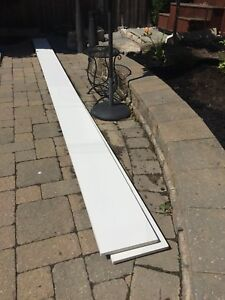 Two pieces, white Azek Composite Decking Trim Board