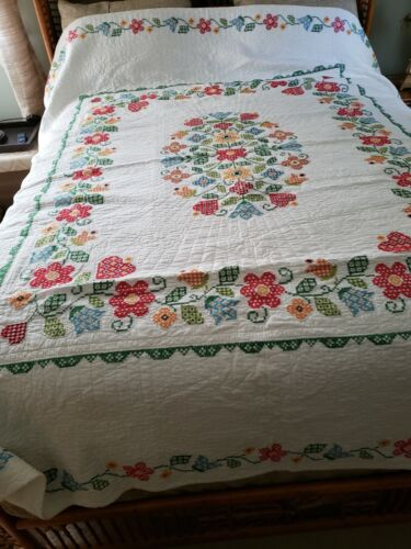 Lovely Hand and cross-stitched quilt.