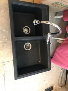 Black sink with faucet