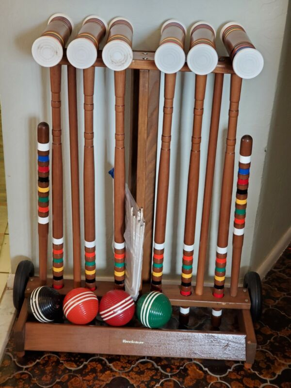 Brookstone Premium Croquet Set, dark brown wood. Works great. Cleaned and tested