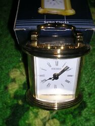 SEIKO  desk clock/bedside clock..alarm.  gold tone case /carriage clock style
