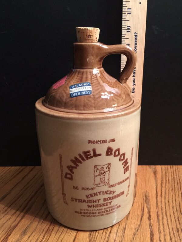 vintage Daniel Boone whiskey crock jug with state and military US Army tax tags