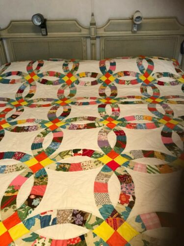 Quilt Hand quilted 73 x 85 never used wedding ring pattern cotton multi color