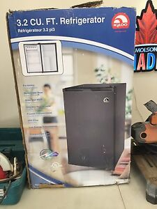 PAWN PRO'S HAS A 3.2 CUBIC FT BAR FRIDGE -NEW