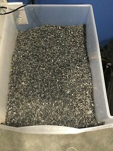 Lots of black/grey fish tank gravel! Enough for a 40gallon!