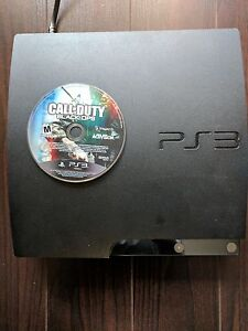 PS3 WITH BLACK OPS NO CONTROLLERS