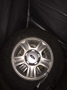 235/70/16 rims and tires off a Ford escape