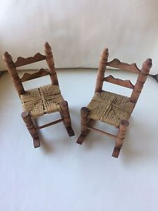 Two toy rocking chairs