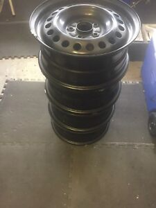 "Steel Rims OEM 16"" 5x114.3 set of 4 like new.."