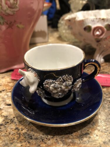 Vintage Demitasse Porcelain Cup And Saucer, Floral Design With Gold Trim  - $10.00