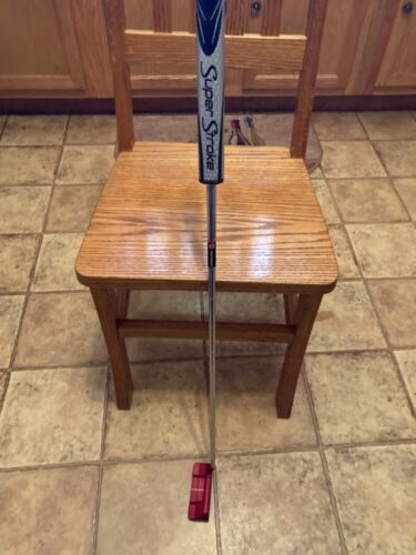 Odyssey 34 inch O Works red putter.New Super Stroke grip and head cover, excelle