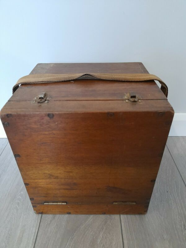Vintage wooden fishing tackle bait box with carrying strap