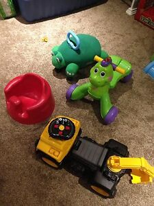 Kids riding toys and Bumbo chair.