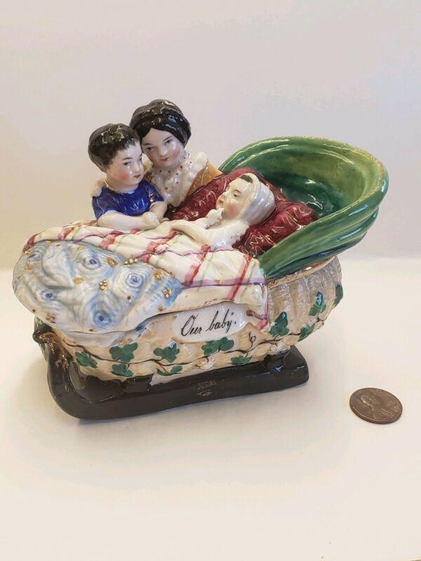 "Large Antique Porcelain Trinket Fairing Box Children w baby bassinet "" Our Baby"""