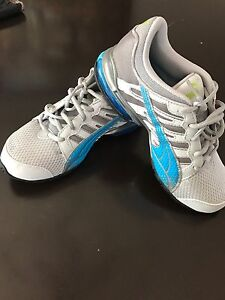 Brand new Puma sports shoes size 4 Youth