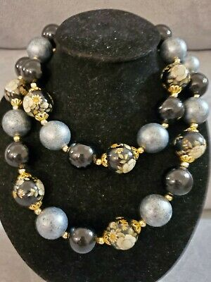 1950s Jewelry Styles and History Vintage 1950s Floral Black & Gold Giant Bead Necklace  $12.99 AT vintagedancer.com