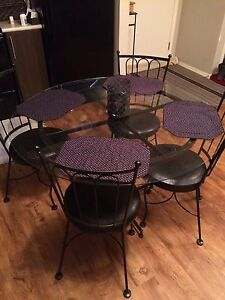 Glass table set with chairs
