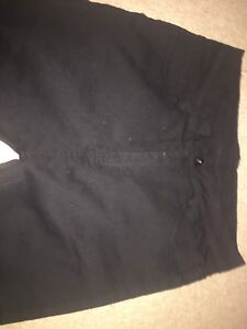 Women's black high rise size small jeans, knee holes