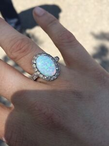 Real Opal ring, sterling silver with diamonds around the gem
