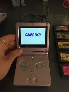Gameboy Nintendo Advanced SP rose avec 23 jeux