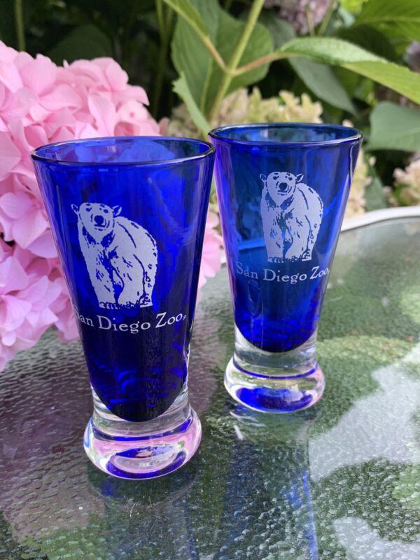 2 cobalt blue glass shot glasses San Diego Zoo Polar Bear clear glass base Crisp