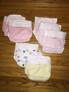 7 flannel diapers and 2 diaper covers. Never used.