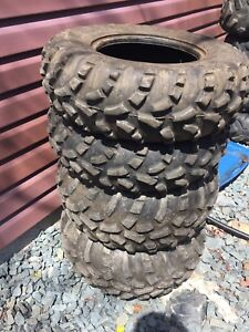 """Tires and rear 12"""" rims off a Honda straight axle"""