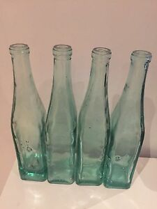 4x clear glass bottles used as display Botany Botany Bay Area Preview