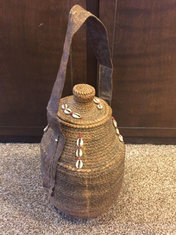 AFRICAN STORAGE,BASKET LIDDED, USED, STITCHED HIDE HANDLE, COWRIE SHELL