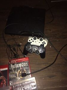 PS3 two controllers and games London Ontario image 7