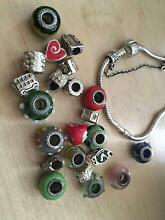 PANDORA 1 SILVER  BRACELET AND 22 CHARMS - URGENT SALE Ryde Ryde Area Preview