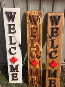 Decorative rustic carved wooden signs