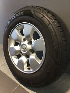 """TOYOTA HILUX SR5/ TOYOTA HIACE 15"""" GENUINE ALLOY WHEELS AND TYRES Carramar Fairfield Area Preview"""