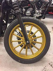 Gold Sportster wheels like new tires included