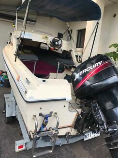 Half cab fibreglass boat with 2006 90hp mercury