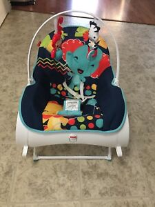 Vibrating baby rocker/chair