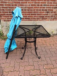 Small black metal outdoor bistro table