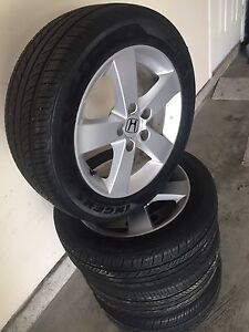 Next to new Honda wheels tires fit other cars too