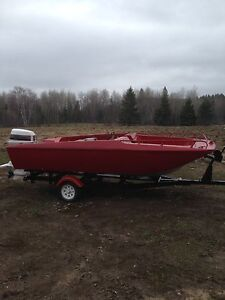Red boat with 90 hp Johnson