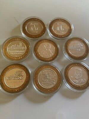 8 Limited edition ten dollar gaming tokens.999 pure silver