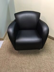 8 Amazing Leather Arm Chairs $150.00 Each.